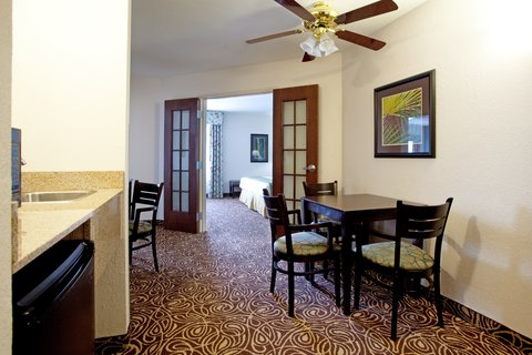 Two Bedroom Suite, sitting area with table and 4 c